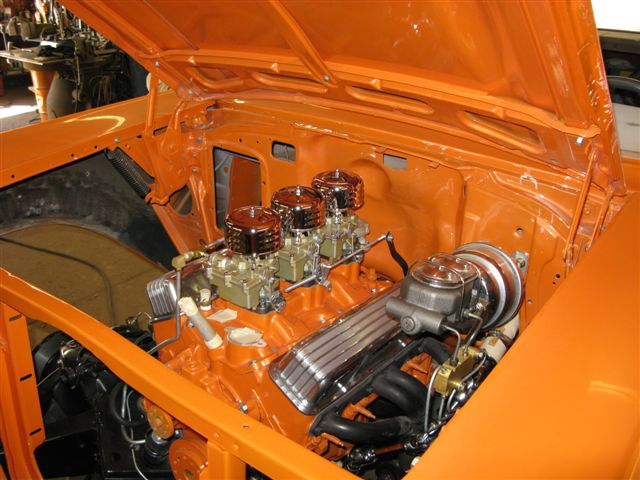 Engine compartment of 57 Chevy with the Gold Pearls and Flakes on the orange base.
