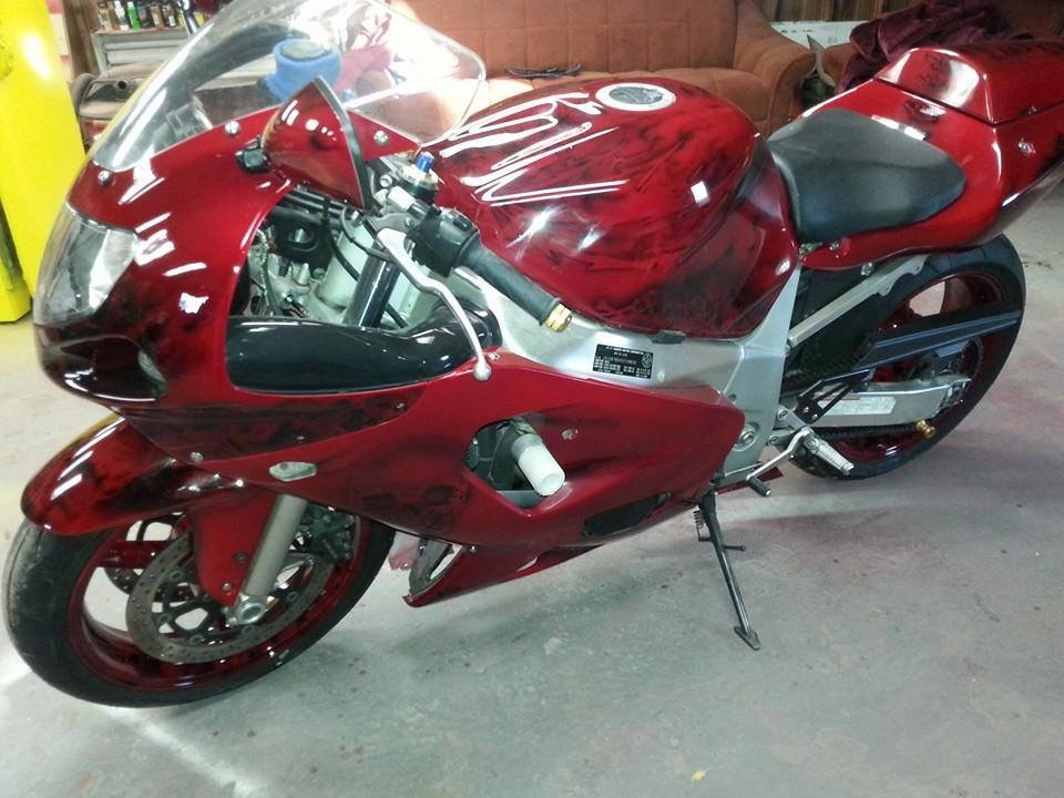 Ruby Red Candy Pearls ® painted on a user's bike.