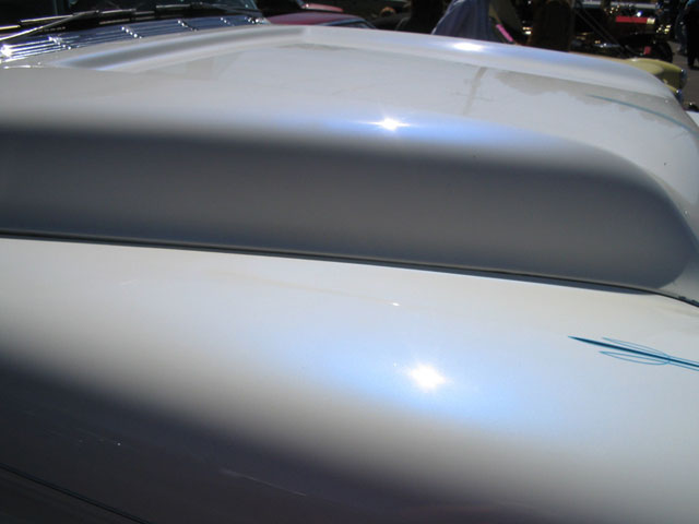 Blue Satin iridescent IGhost Pearls ® on White Hood