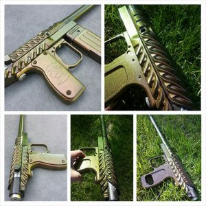 Paintball gun with 4739CS Gold Green Bronze Chameleon Pearls powder coated on the surface.